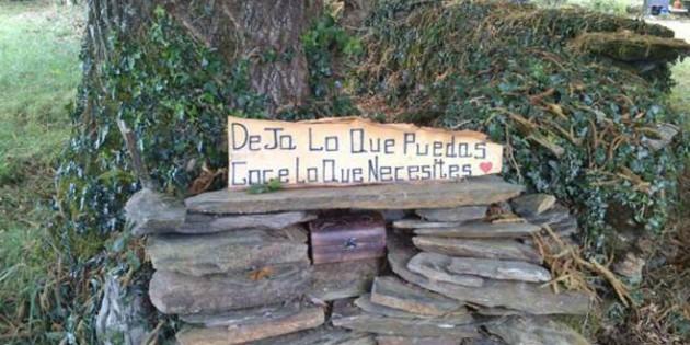 """Cartel en Ocuoso: """"Deja lo que puedas y coge lo que necesites""""."""